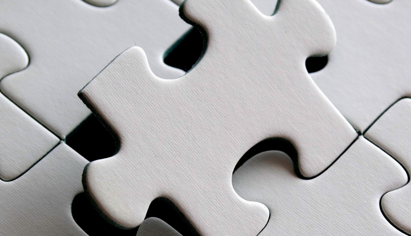 Puzzle Piece fitting a puzzle